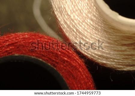 Sewing thread spool macro photo. #1744959773