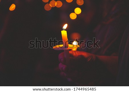 This picture is of people doing a candle lighting during the holidays