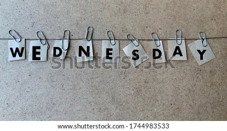 Wednesday.The word environment on a wooden background.Photos for a holiday, day, calendar, banner, Wallpaper, and desktop.Midweek .Working day.Business concept Royalty-Free Stock Photo #1744983533