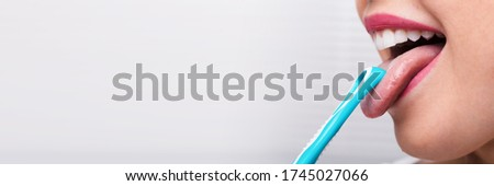 Tongue Scraper Cleaner. Oral Cleaning And Care  Royalty-Free Stock Photo #1745027066