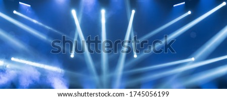 Show must go on. Empty stage with blue spotlights. Blue stage lights. Concert live streams available online. Background for online concert. Live streaming concert. Online event. Stage for musicians #1745056199