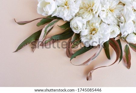Stylized stock photo, decorative still lifes, flower compassion. Wedding or holiday bouquet of white roses and branches of a dry eucalyptus. Concept of Mother's Day, Family Day, Valentine's Day. #1745085446