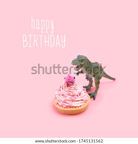 happy birthday greeting card. dinosaur and cupcake on pink background.  creative minimal concept.