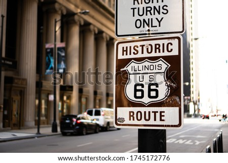 Picture of a famous route 66 sign at the beginning of the famous route in downtown chicago, illinois.