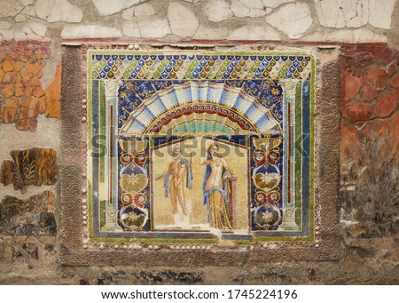Wall mosaic of Neptune and Amphitrite in Ercolano (Herculaneum), Italy. Herculaneum was buried in the eruption of Mount Vesuvius in AD 79 and is now a UNESCO World Heritage Site.
