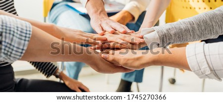 Panoramic teamwork business join hand together concept, Business team standing hands together, Volunteer charity work. People joining for cooperation success business. Royalty-Free Stock Photo #1745270366