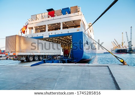 Ferry and Trucking Transportation - RO-RO Transport (Roll On/Roll Off) Royalty-Free Stock Photo #1745285816