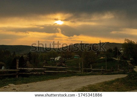 Beautiful sunset colors over the mountains of Carpathian, Ukraine, Europe. Sun setting after hot summer day. Photo in orange and blue natural tones #1745341886