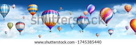Hot air ballons over cloudy sky.EPS 10 contains transparency. Royalty-Free Stock Photo #1745385440