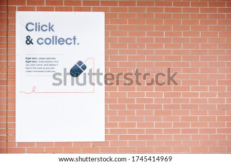 Click collect online internet shopping sign at shop