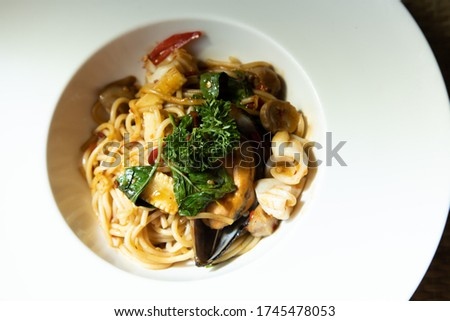The pattern seafood spaghetti in white dish