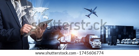 Business Logistics concept, Businessman manager touching icon of logistics for workers with Modern Trade warehouse logistics Global business connection technology interface global partner connection  #1745606774