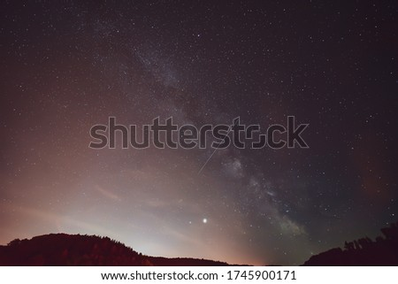 Spring Milky Way and satellites in the night sky.