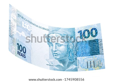 banknote of one hundred reais from brazil falling on isolated white background Royalty-Free Stock Photo #1745908556