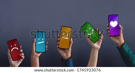 Customer Experiences Concept. Group of Diversity People Giving Feedback via Mobile Phone, from Negative to Positive Review. Poor to Excellent. Client's Satisfaction Surveys on Mobile Phone Royalty-Free Stock Photo #1745923076