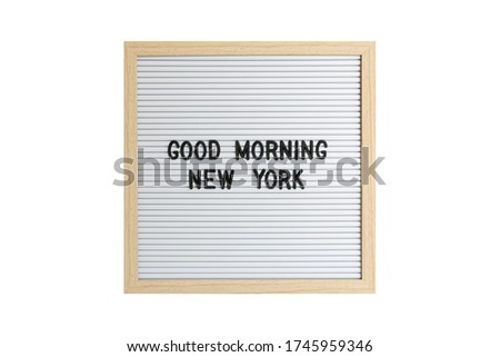 Good Morning New York text on a plastic board isolated on white with black characters font.