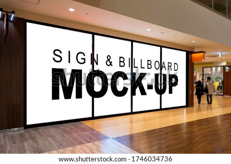 Mock up blank large billboard with clipping path on glassy showcase window in shopping mall interior. empty space for insert advertising graphic design  Royalty-Free Stock Photo #1746034736