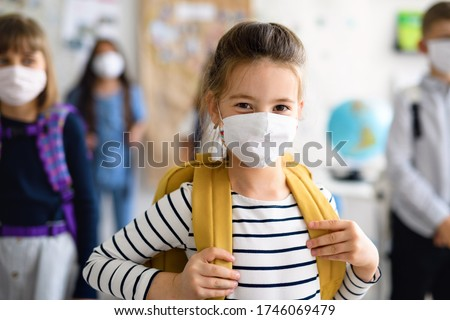 Child with face mask going back to school after covid-19 quarantine and lockdown. Royalty-Free Stock Photo #1746069479