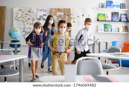 Group of children with face mask back at school after covid-19 quarantine and lockdown. #1746069482