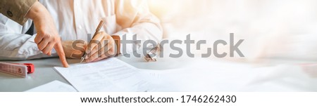 Business people negotiating a contract. Sign a contract business. Panoramic banner with copy space.