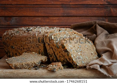 Loaf of einkorn bread with pumpkin and sunflower seeds slices. #1746268151