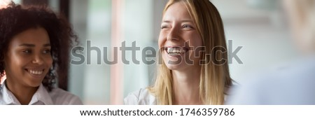 Businesswoman leader laughing at funny joke at group meeting with diverse colleagues. Team building workshop activity, good relations at work concept. Horizontal photo banner for website header design