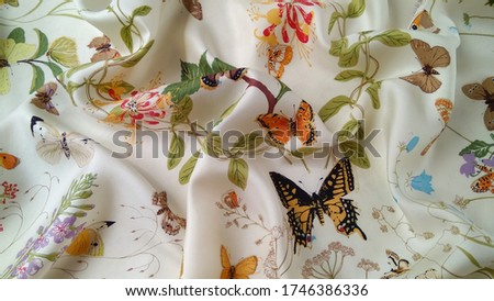 Silk fabric with beautiful butterflies and flowers on the white background. Romantic, multicolored natural, exotic, floral, lovely picture.