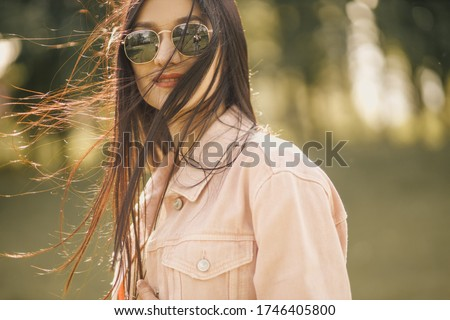 Exterior fashion photo of young pretty lady in sunglasses. Travel to Summer Beach. Summer vibrations. Eyeglass concept for eyesight. #1746405800