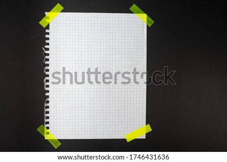 White paper rectangle with tape on a dark background. Place for the text. Vector illustration. The paper in the cage is glued with yellow stickers.