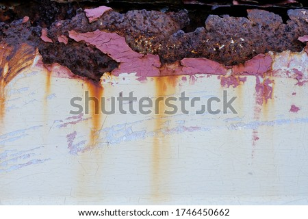 Rusted and corroded on metal white background. Rusty. Rusted white painted metal wall. Rusty metal background with streaks of rust. Rust stains. The metal surface rusted spots. #1746450662