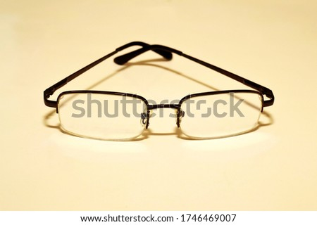 glasses for improving vision in a white background	  #1746469007