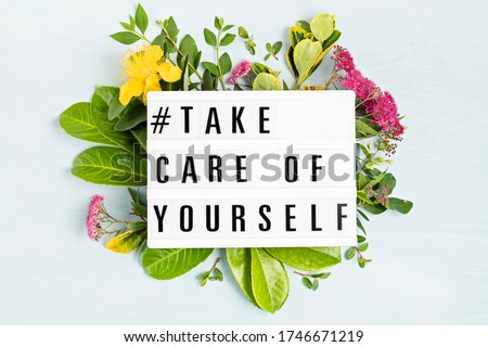 Lightbox with motivation words for self care, positive thinking, mental health, emotional wellness. Top view. Royalty-Free Stock Photo #1746671219
