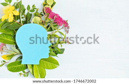 Papercut head with green leaves and flowers. Mental health, emotional wellness, contented emotions, self care, psychology, green thinking, ecology concept Royalty-Free Stock Photo #1746672002