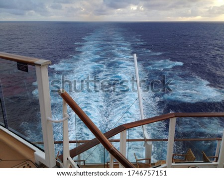 View of the trail in the ocean from the stern of a cruiseship