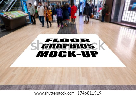 Mock up large blank screen for graphic with clipping path on walkway in shopping mall, blurred many people walking, empty space for insert advertising, graphic design or information