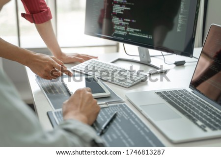 Development programmer writing a code on database, Teamwork cooperation. Royalty-Free Stock Photo #1746813287