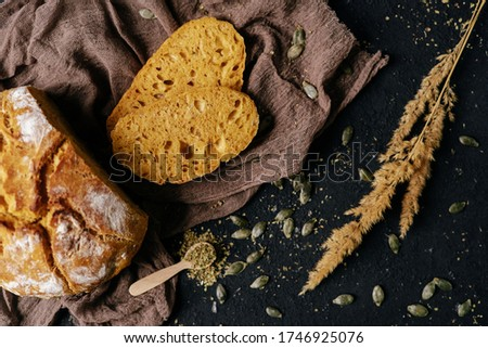 Bread Sliced Fresh Baked Traditional Nutrition Top View Studio Photo. Cooked Nourishment Loaf Piece on Fabric Napkin, Spice, Pumpkin Seeds and Dried Plant Branch on Kitchen Desk. Tasty Food #1746925076