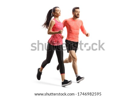 Full length shot of a man and woman in sportswear running together isolated on white background Royalty-Free Stock Photo #1746982595