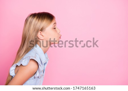 Close-up profile side view portrait of her she nice attractive lovely pretty charming dreamy affectionate girl sending air kiss mom mother day isolated over pink pastel color background