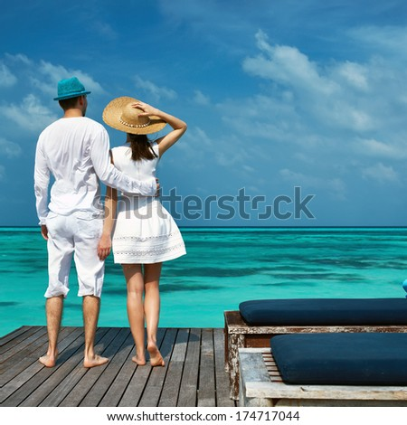 Couple on a tropical beach jetty at Maldives #174717044