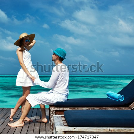 Couple on a tropical beach jetty at Maldives #174717047