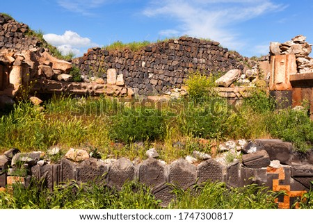 The ruins of the Armenian Christian temple on a bright spring sunny day,the remains of the altar, decorated with stone plates of openwork #1747300817