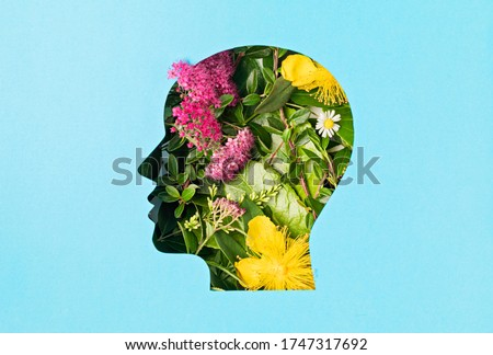Papercut head with green leaves and flowers. Mental health, emotional wellness, contented emotions, self care, psychology, green thinking, ecology concept Royalty-Free Stock Photo #1747317692