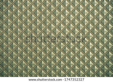 Golden vintage background with small symmetrical rhombus.