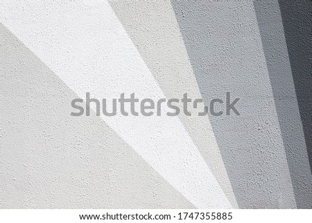 Closeup of gradient gray urban wall texture. Modern pattern for wallpaper design. Creative urban city background. Abstract open composition. Minimal geometric style, solid colors