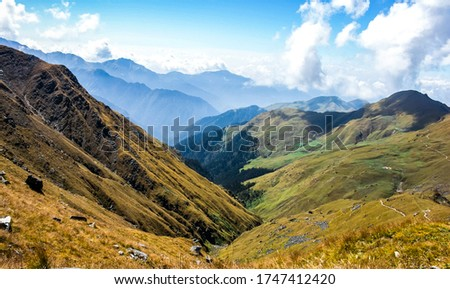 Green layered mountains of Roopkund, Uttarakhand, India. Roopkund trek is a famous trekking hub is visited by thousands of trekkers. Nature mountains in Uttarakhand, India. Adventure in India. - Image #1747412420