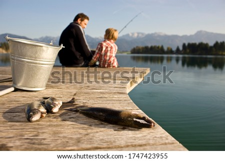 Father and son fishing in lake #1747423955
