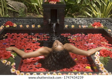 Young woman relaxing at tranquil spa #1747434239