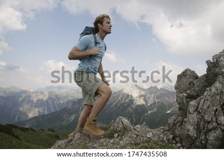 Man hiking up mountain, Kleinwalsertal, Allgau, Germany #1747435508