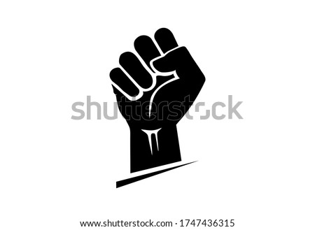 Black hand raised in a clenched fist. Freedom sign and protest symbol - civil rights movement, black lives matter icon. Royalty-Free Stock Photo #1747436315